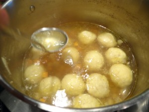matzo balls cooking in stewing hen broth