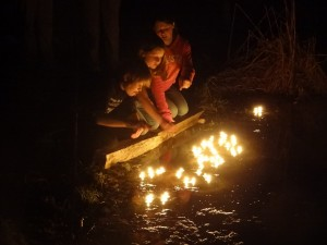 lighting candles in farm's pond in honor of Roy & Liz's 50th Anniversary