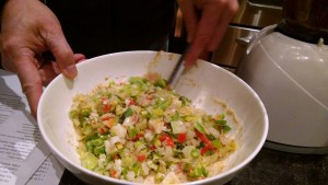 mixing leek fritter ingredients