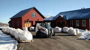 pallets staged at the inn rock dust skid steer
