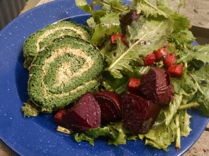 spinach roulade slices with spring roasted beets and greens salad