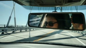 chloe driving on bridge