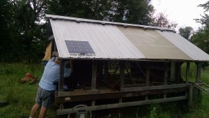 john installing solar on hen wagon