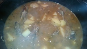 goat loin bones cooking in birria stock